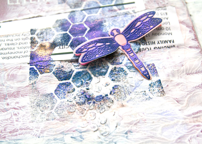 Close-up of the left-hand page from the Embossing Powders With Stencils Video by Kim Dellow