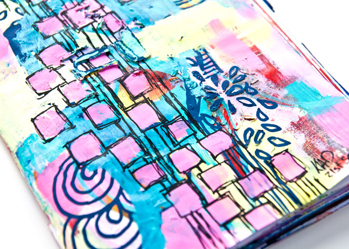close-up of bright art journal page of pink, yellow and turquoise and lots of doodles by Kim Dellow