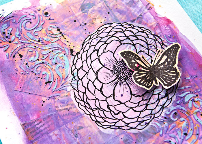 An art journal page by Kim Dellow using acrylic inks to layer colors with a stamped butterfly and hand drawn flower