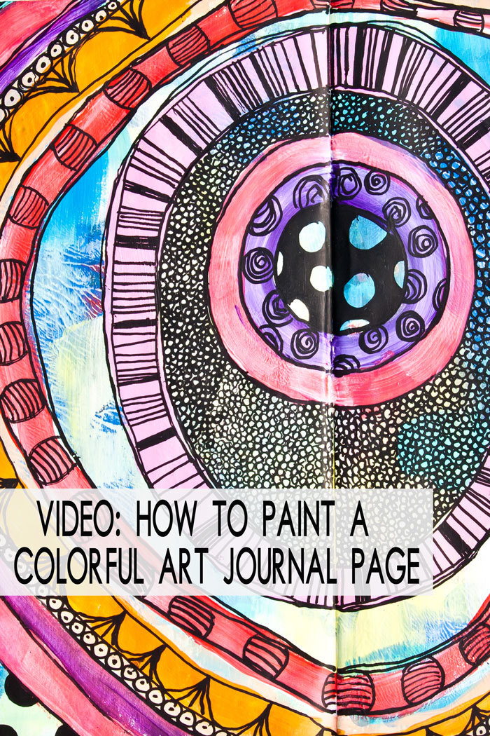 Close up of part of an art journal page with different colored circles and doodling