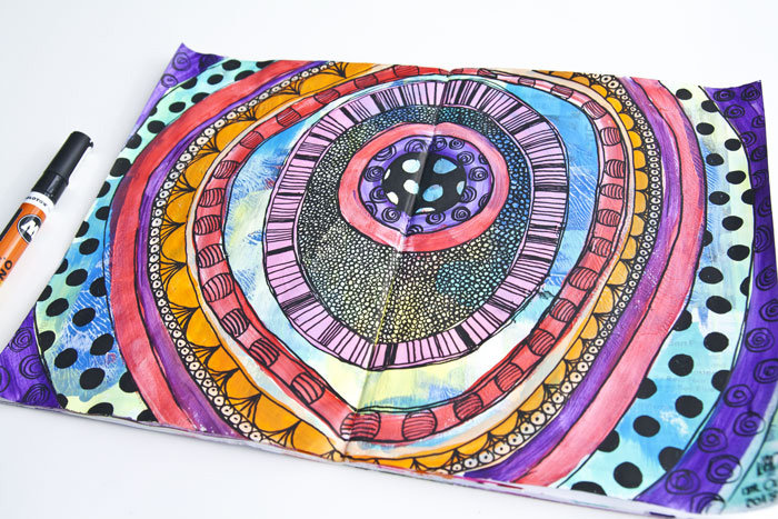 art journal page with different colored circles and doodling