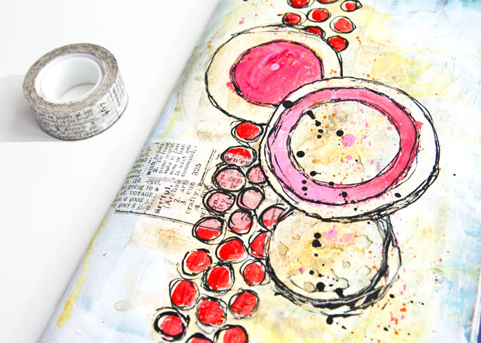close-up of Painted art journal page by Kim Dellow with die-cut circle texture