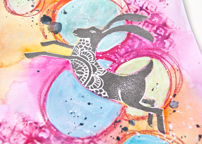 Close up of a gray hare image on a colorful background from art done by Kim Dellow