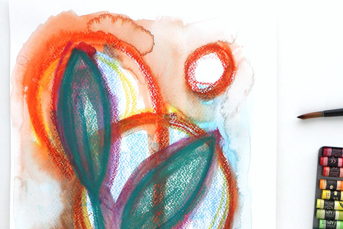 Close-up of abstract scribble by Kim Dellow in orange, green and pinks