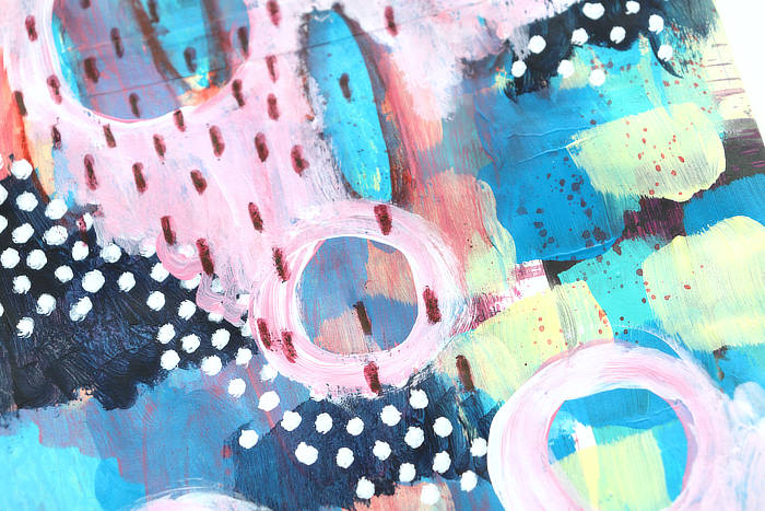 close-up of Art journal page in pink and blue, mark making and paint by Kim Dellow