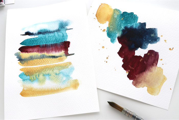 Close up of two Watercolour abstracts in jewel colours by Kim Dellow